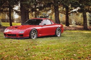 This is one GORGEOUS RX-7 rolling on Race Star Wheels and stuffed with an LS6 an...