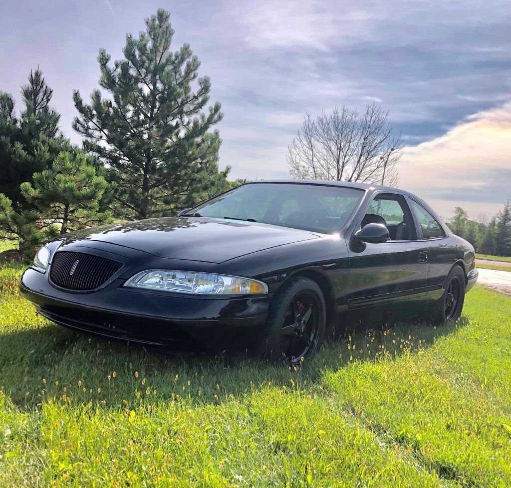 "From the ""you don't see this everyday"" file, a 1998 Lincoln Mark VIII, hub swapp..."
