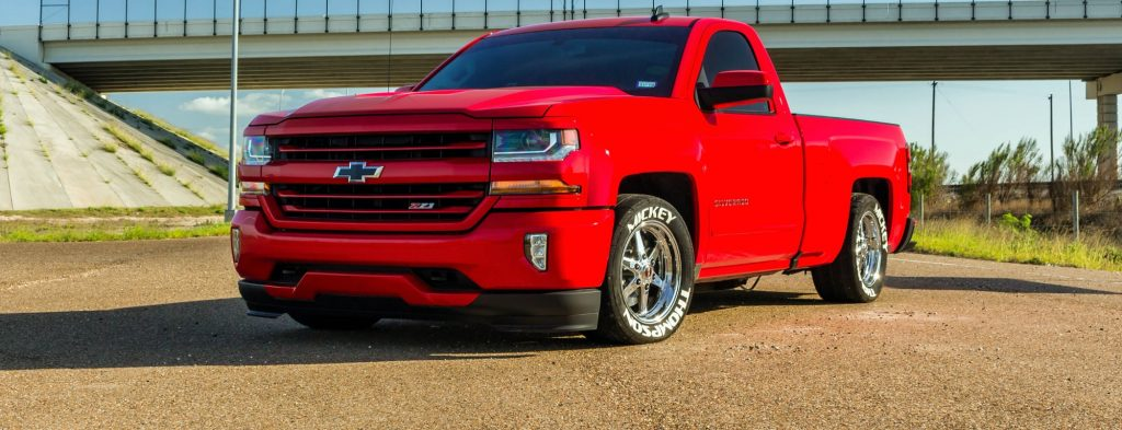 Red Hot boosted Chevy Silverado rolling on 17